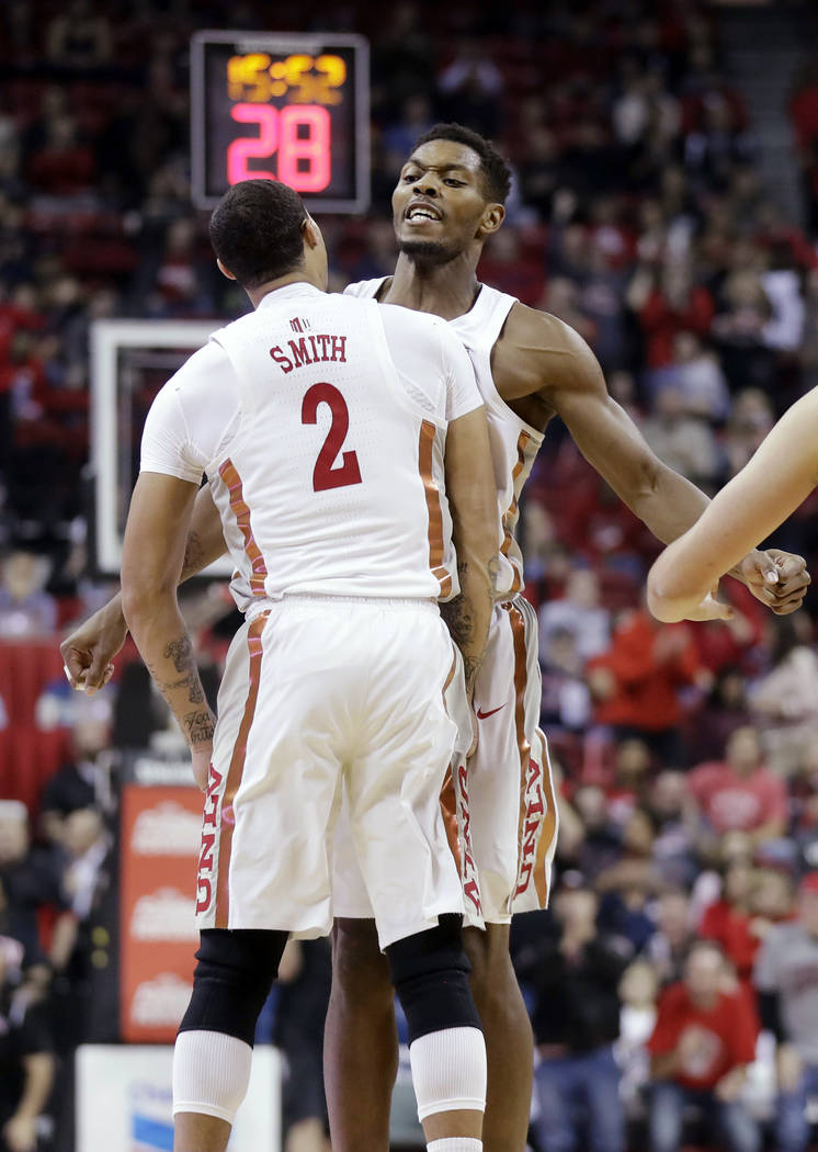 UNLV's Anthony Smith (2) and Shakur Juiston celebrate during the first half of an NCAA college basketball game against Arizona on Saturday, Dec. 2, 2017, in Las Vegas. (AP Photo/Isaac Brekken)
