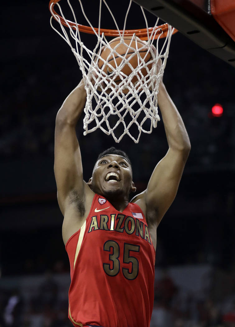 Arizona's Allonzo Trier dunks during the first half of an NCAA college basketball game against Arizona on Saturday, Dec. 2, 2017, in Las Vegas. (AP Photo/Isaac Brekken)