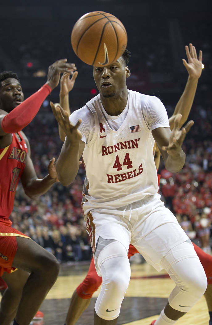 UNLV Rebels forward Brandon McCoy (44) reaches for the loose ball during the first half of an NCAA college basketball game against the Arizona Wildcats at Thomas & Mack Center in Las Vegas on  ...