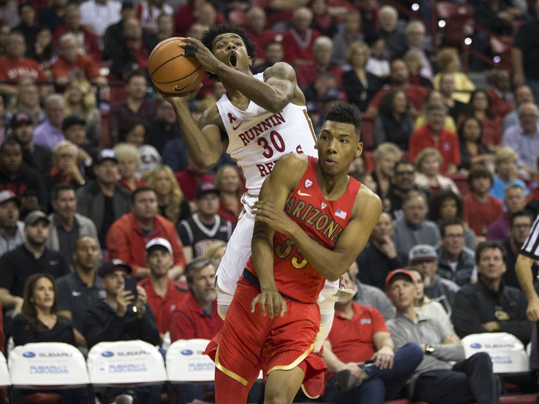 UNLV Rebels guard Jovan Mooring (30) takes a shot over Arizona Wildcats guard Allonzo Trier (35) during the first half of an NCAA college basketball game at Thomas & Mack Center in Las Vegas o ...