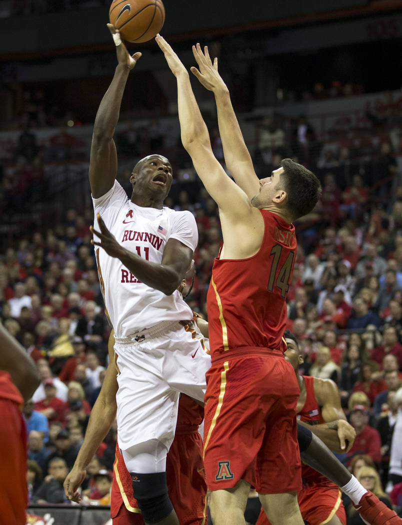 UNLV Rebels forward Cheickna Dembele (11) shoots over Arizona Wildcats center Dusan Ristic (14) during the second half of an NCAA college basketball game at Thomas & Mack Center in Las Vegas o ...