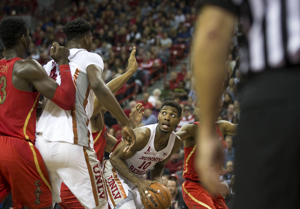 UNLV Rebels forward Shakur Juiston (10) looks for the basket during the second half of an NCAA college basketball game against the Arizona Wildcats at Thomas & Mack Center in Las Vegas on Satu ...
