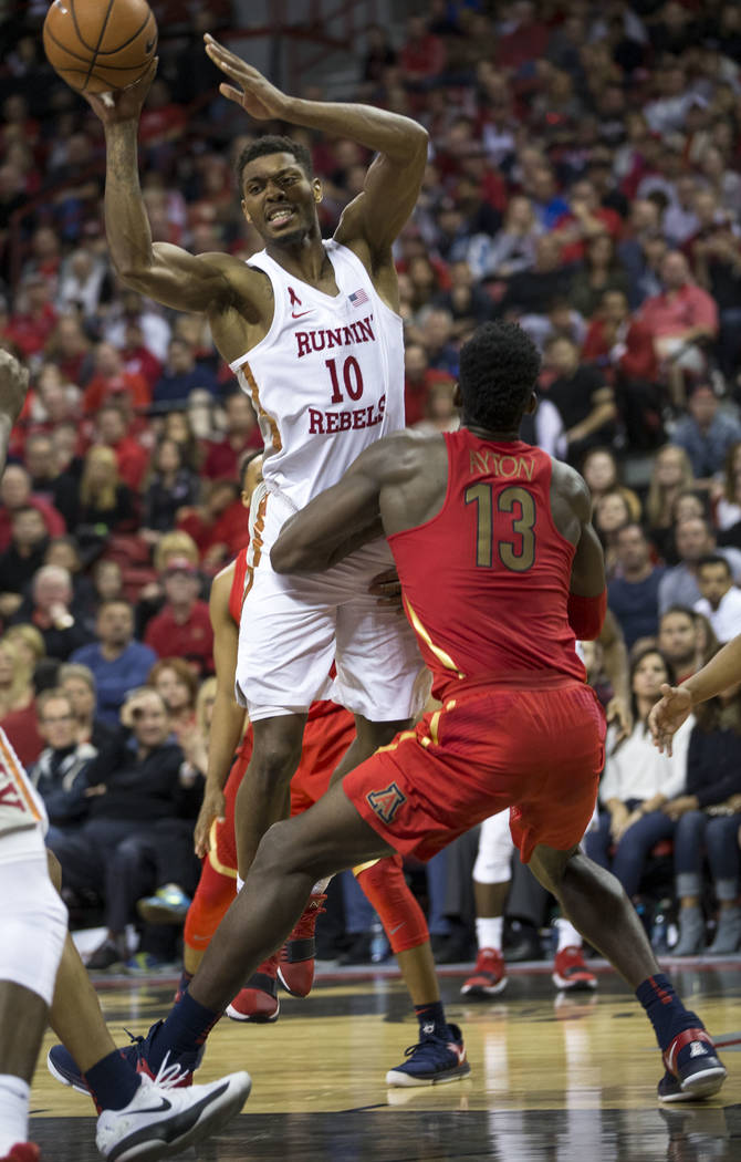 UNLV Rebels forward Shakur Juiston (10) takes a shot over Arizona Wildcats forward Deandre Ayton (13) during the second half of an NCAA college basketball game at Thomas & Mack Center in Las V ...
