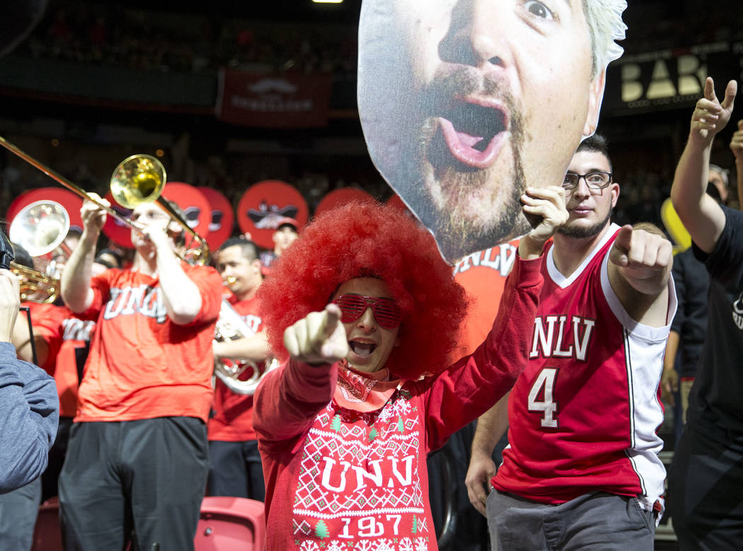 UNLV fans cheers on their team during the second half of an NCAA college basketball game against UNLV Rebels and Arizona Wildcats at Thomas & Mack Center in Las Vegas on Saturday, Dec. 2, 2017 ...
