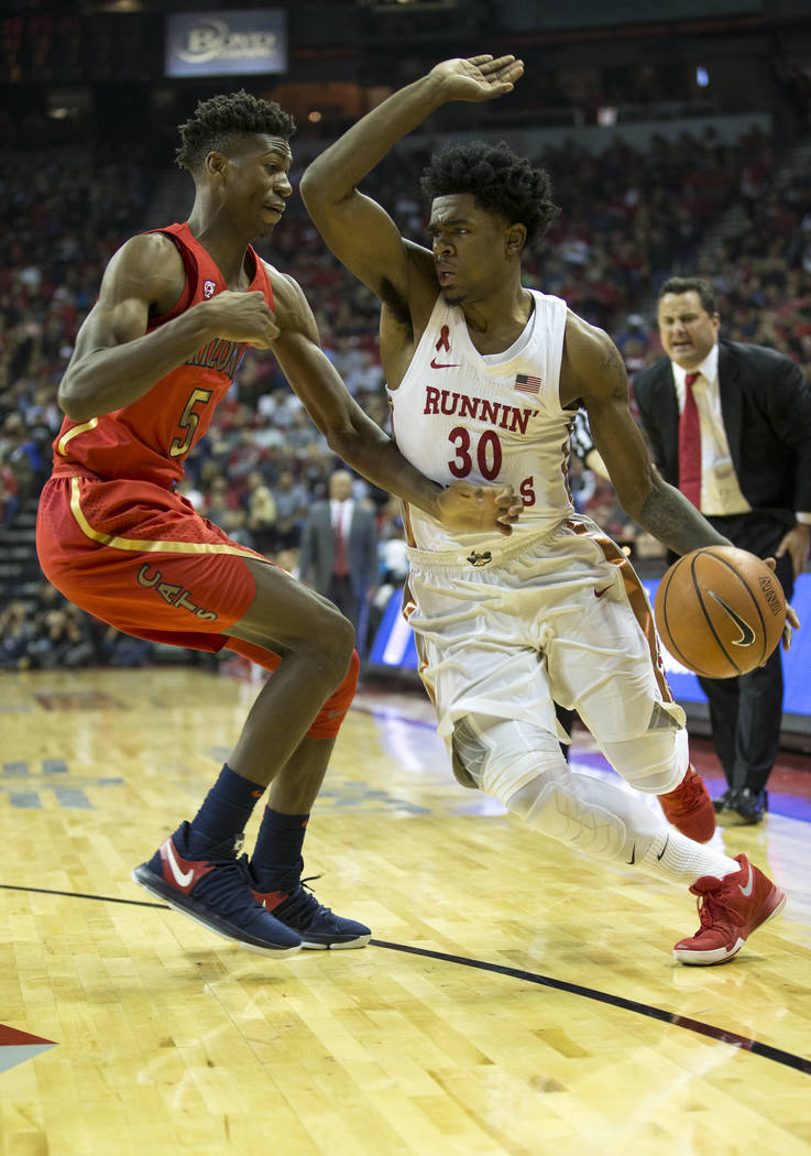 UNLV Rebels guard Jovan Mooring (30) drives the ball past Arizona Wildcats guard Brandon Randolph (5) during the first half of an NCAA college basketball game at Thomas & Mack Center in Las Ve ...