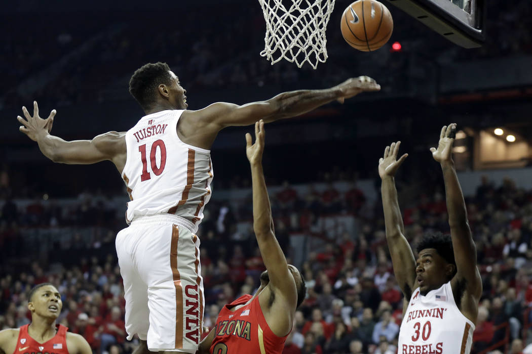 UNLV's Shakur Juiston (10) blocks a shot from Arizona's Parker Jackson-Cartwright during the first half of an NCAA college basketball game Saturday, Dec. 2, 2017, in Las Vegas. (AP Photo/Isaac Bre ...