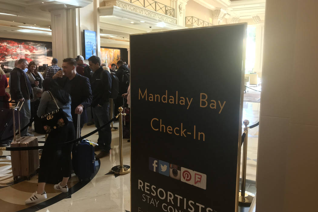 Visitors wait in a long line to check in at Mandalay Bay hotel-casino in Las Vegas, Tuesday, Nov. 28, 2017. Bridget Bennett Las Vegas Review-Journal