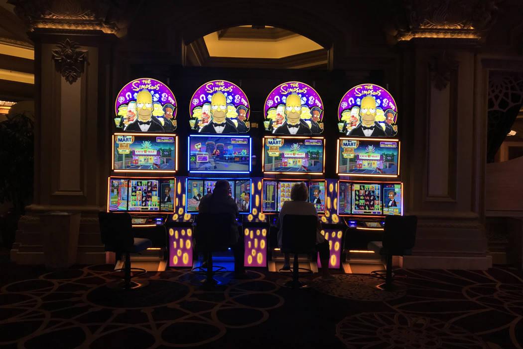 A couple play machines at Mandalay Bay hotel-casino in Las Vegas, Tuesday, Nov. 28, 2017. Bridget Bennett Las Vegas Review-Journal