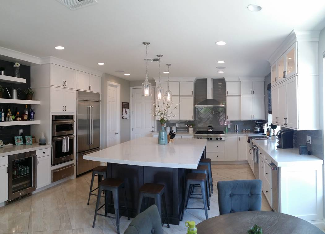Designer Kitchens and Baths A large kitchen island can be used for seating and prep work.
