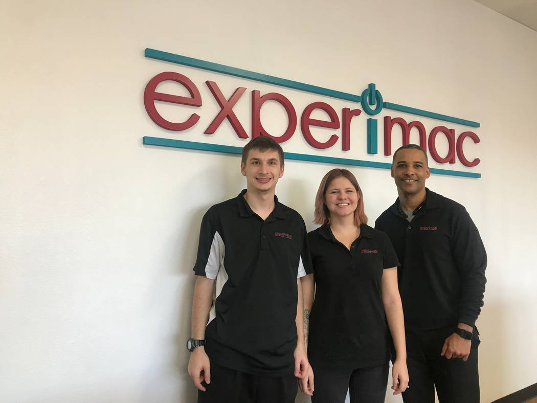 Experimac employees, from left, Jared Thiel, Melisa Thiel and owner Brando Younger pose for a portrait on Nov. 24, 2017 at the North Las Vegas store, 5515 Camino Al Norte #105. (Kailyn Brown/View) ...