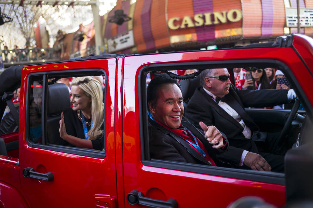 Holly Madison, left, and Wayne Newton lead race participants to the starting line before the start of the Las Vegas Great Santa Run in downtown Las Vegas on Saturday, Dec. 2, 2017. Chase Stevens L ...