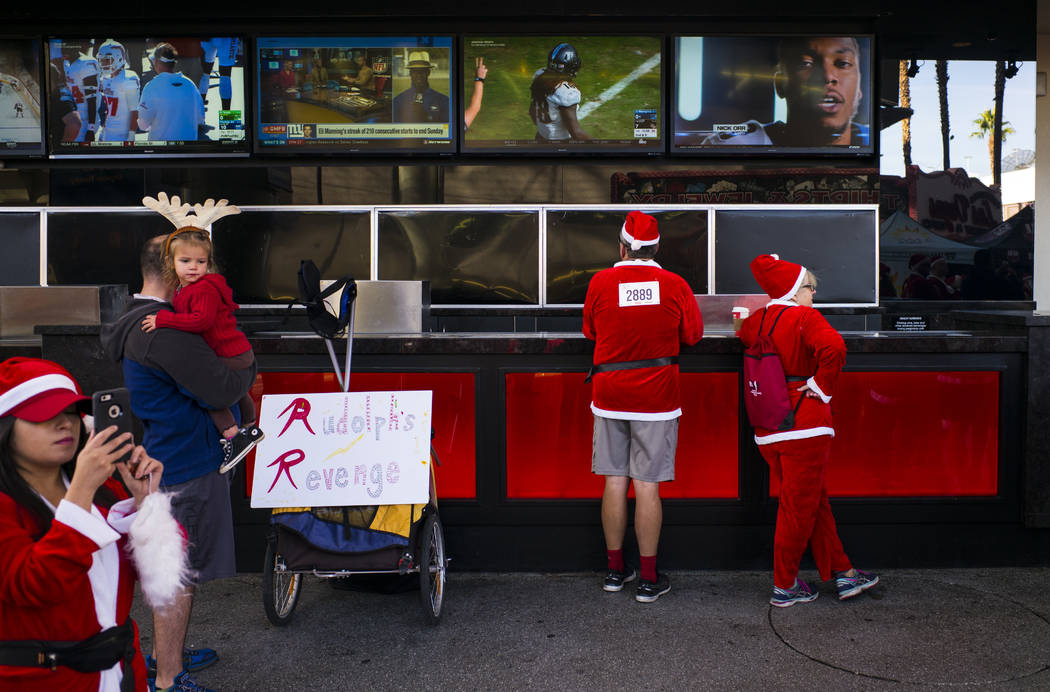 Loraine and Larry Biggers, right, wait for the start of the Las Vegas Great Santa Run in downtown Las Vegas on Saturday, Dec. 2, 2017. Chase Stevens Las Vegas Review-Journal @csstevensphoto