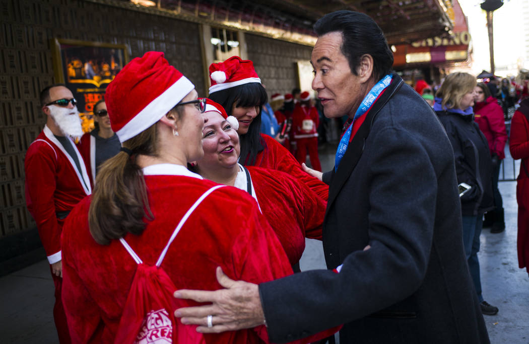 Wayne Newton greets race participants before the start of the Las Vegas Great Santa Run in downtown Las Vegas on Saturday, Dec. 2, 2017. Chase Stevens Las Vegas Review-Journal @csstevensphoto