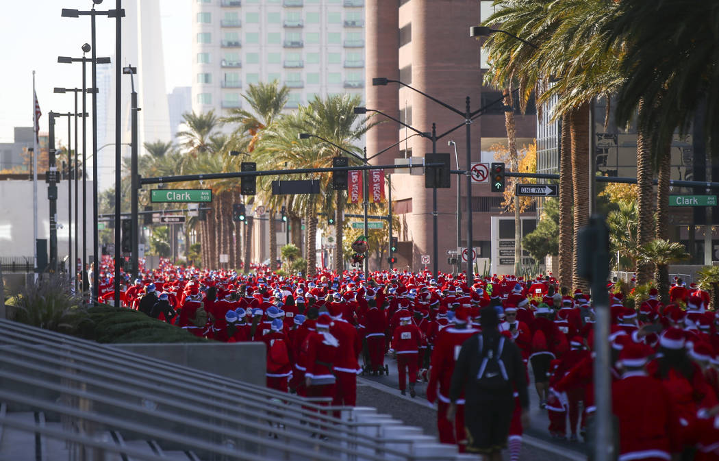 People participate during the Las Vegas Great Santa Run in downtown Las Vegas on Saturday, Dec. 2, 2017. Chase Stevens Las Vegas Review-Journal @csstevensphoto