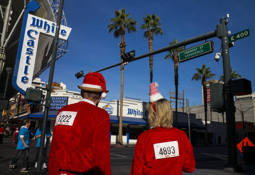 Participants along Fremont Street before the start of the Las Vegas Great Santa Run in downtown Las Vegas on Saturday, Dec. 2, 2017. Chase Stevens Las Vegas Review-Journal @csstevensphoto