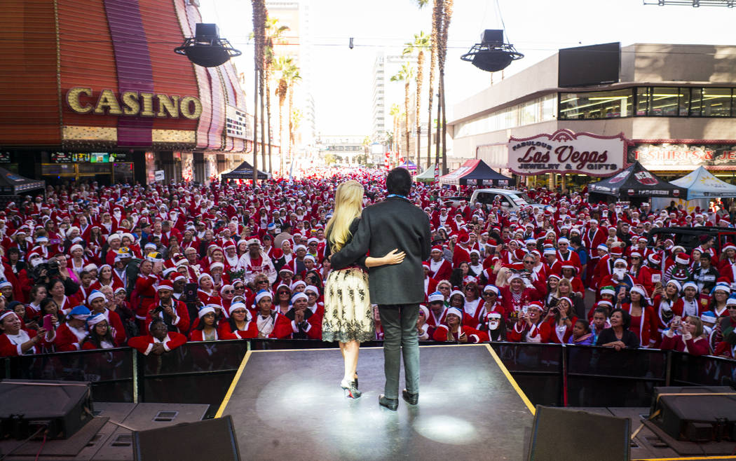 Wayne Newton and Holly Madison on stage before the start of the Las Vegas Great Santa Run in downtown Las Vegas on Saturday, Dec. 2, 2017. Chase Stevens Las Vegas Review-Journal @csstevensphoto