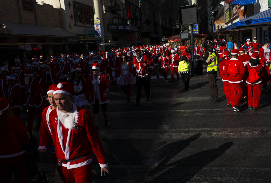 Race participants make their way towards the starting line for the Las Vegas Great Santa Run in downtown Las Vegas on Saturday, Dec. 2, 2017. Chase Stevens Las Vegas Review-Journal @csstevensphoto