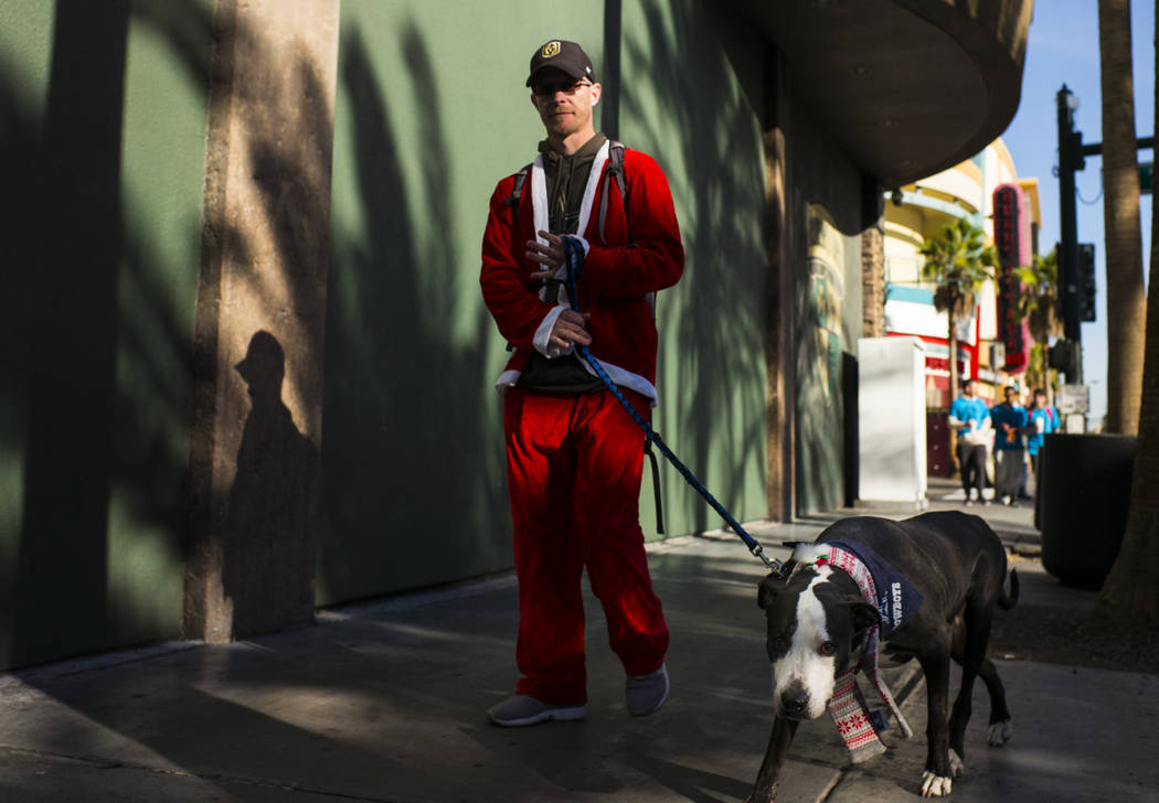 Bran Paletta of Henderson with his dog Dallas before the start of the Las Vegas Great Santa Run in downtown Las Vegas on Saturday, Dec. 2, 2017. Chase Stevens Las Vegas Review-Journal @csstevensphoto