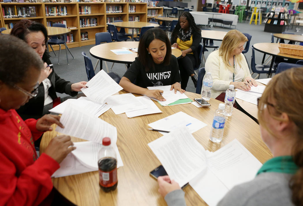 Valley High School junior Omega Gdeye, center, leads a meeting for the school organizational team, Monday, Nov. 27, 2017 in Las Vegas. Elizabeth Brumley Las Vegas Review-Journal @EliPagePhoto