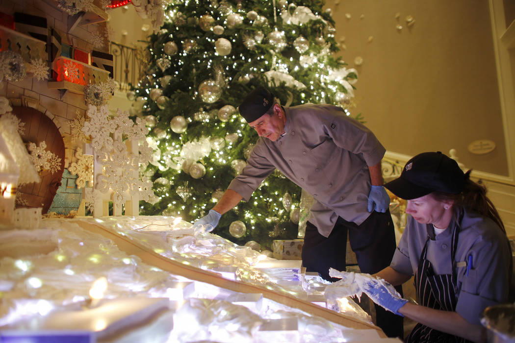 Pastry cook Frank Pedroza, and pastry cook Courtney Williams smooth out frosting for the cover of snow at the winter village at the Four Seasons in Las Vegas, Tuesday, Nov. 21, 2017. Rachel Aston  ...