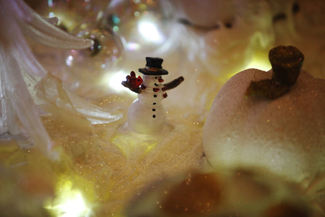 A snowman figurine at the winter village at the Four Seasons in Las Vegas, Wednesday, Nov. 22, 2017. The frosting alone takes 250 pounds of powdered sugar and five gallons of egg whites. Rachel As ...