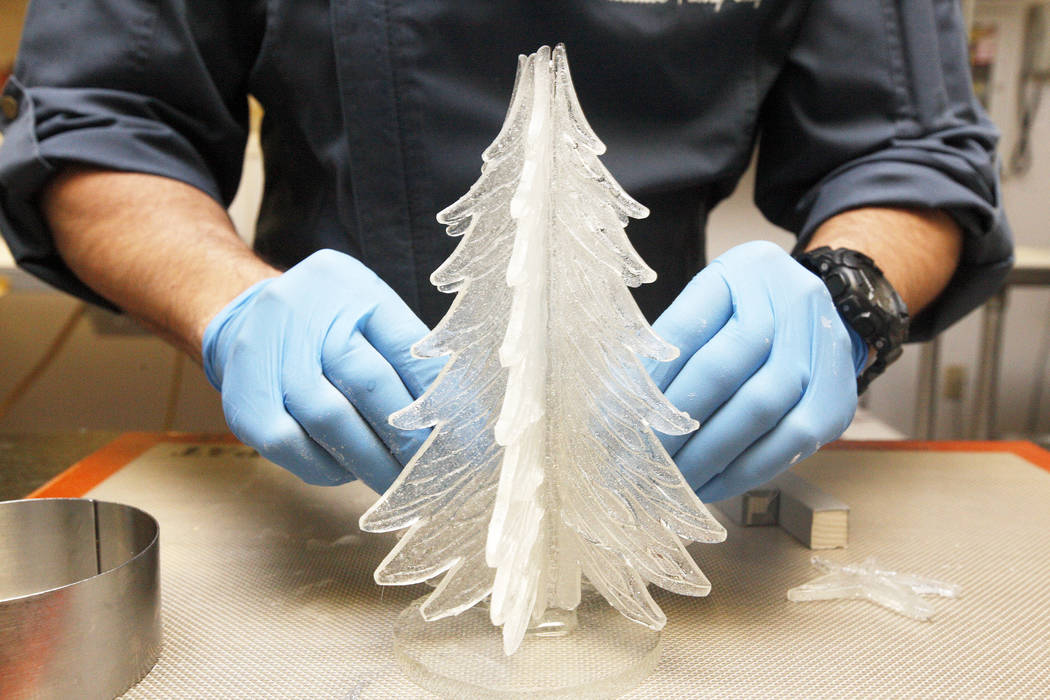 Executive Pastry Chef Jean-Luc Daul attaches parts of a sugar Christmas tree together for a winter village at the Four Seasons in Las Vegas, Tuesday, Nov. 14, 2017. Rachel Aston Las Vegas Review-J ...