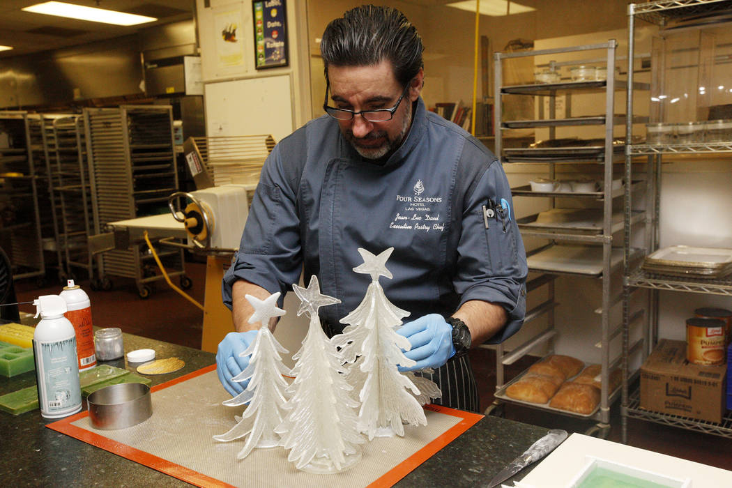 Executive Pastry Chef Jean-Luc Daul places sugar Christmas trees, all to be used for a winter village, at the Four Seasons in Las Vegas, Tuesday, Nov. 14, 2017. Rachel Aston Las Vegas Review-Journ ...