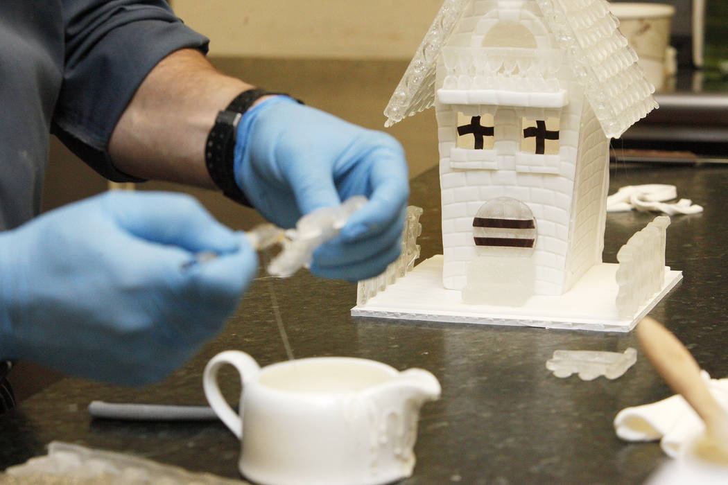 Executive Pastry Chef Jean-Luc Daul adds cooked sugar to a sugar fence for a house at the Four Seasons in Las Vegas, Tuesday, Nov. 14, 2017. The piece will be a part of a winter village.  Rachel A ...