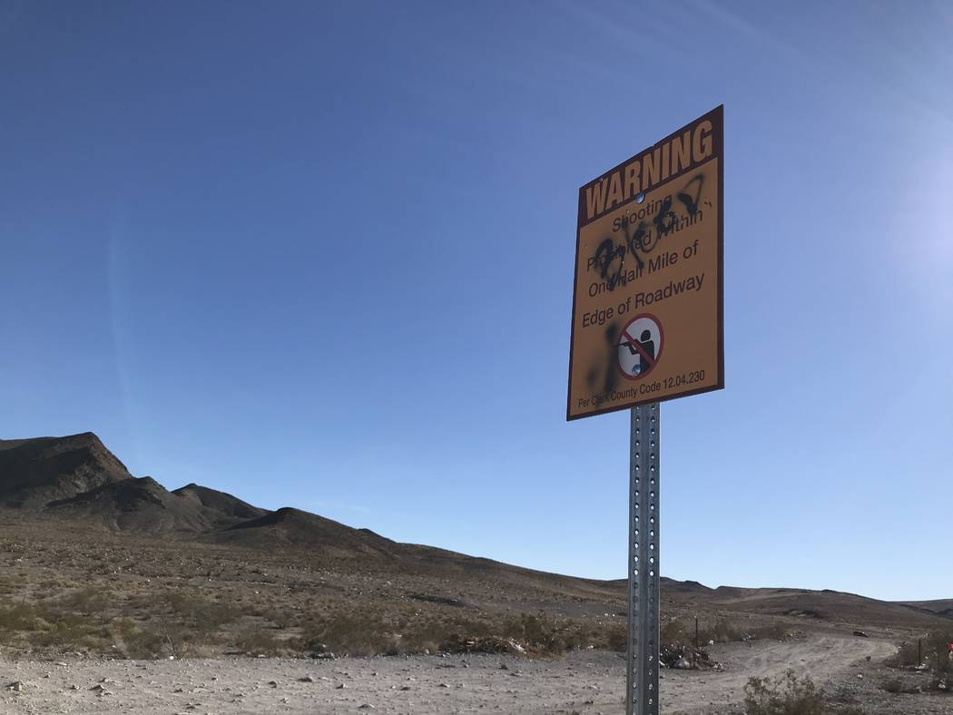 Graffiti obscures part of a sign outlining Clark County regulations at a popular target shooting area on public land just south of the Las Vegas Valley, Tuesday, Nov. 28, 2017. Henry Brean Las Veg ...