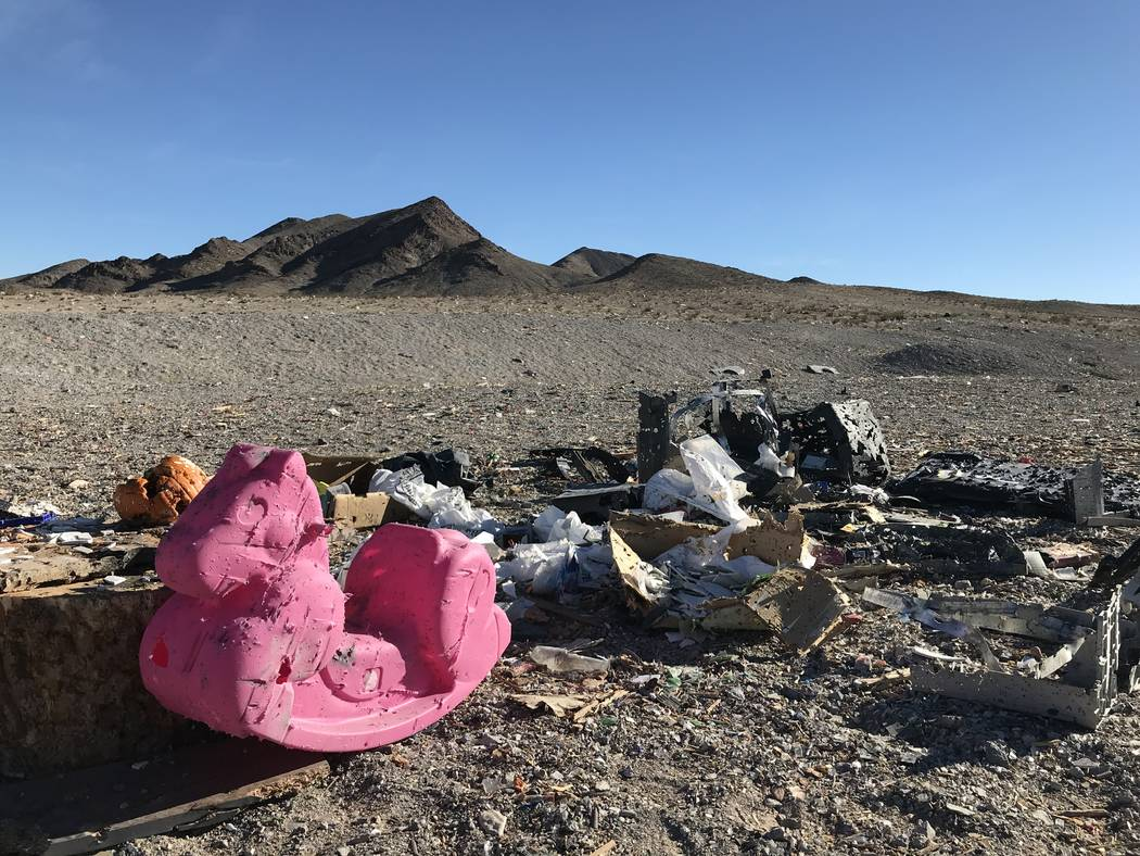 A plastic rocking horse and other debris litters a popular target shooting area on public land just south of the Las Vegas Valley, Tuesday, Nov. 28, 2017. Henry Brean Las Vegas Review-Journal