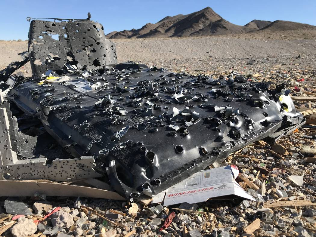 Bullet holes cover a flat-screen television used for target practice at a popular shooting area south of the Las Vegas Valley, Tuesday, Nov. 28, 2017. Henry Brean Las Vegas Review-Journal