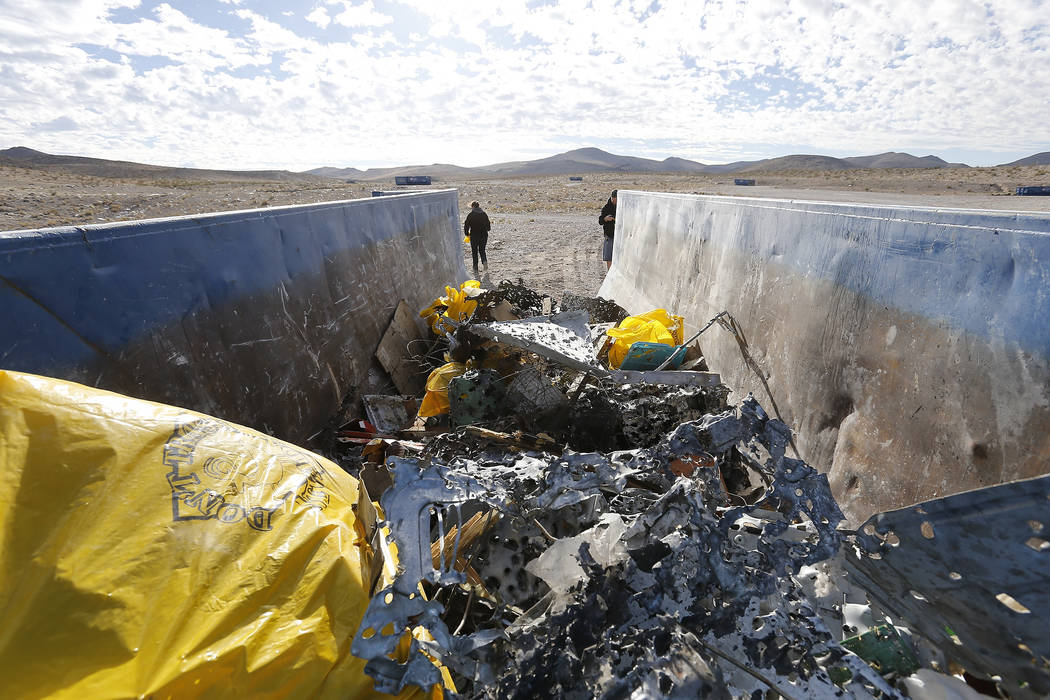 A dumpster begins to fill with trash collected during a volunteer cleanup hosted by the Bureau of Land Management at a popular target shooting area off South Las Vegas Boulevard, Saturday, Nov. 04 ...