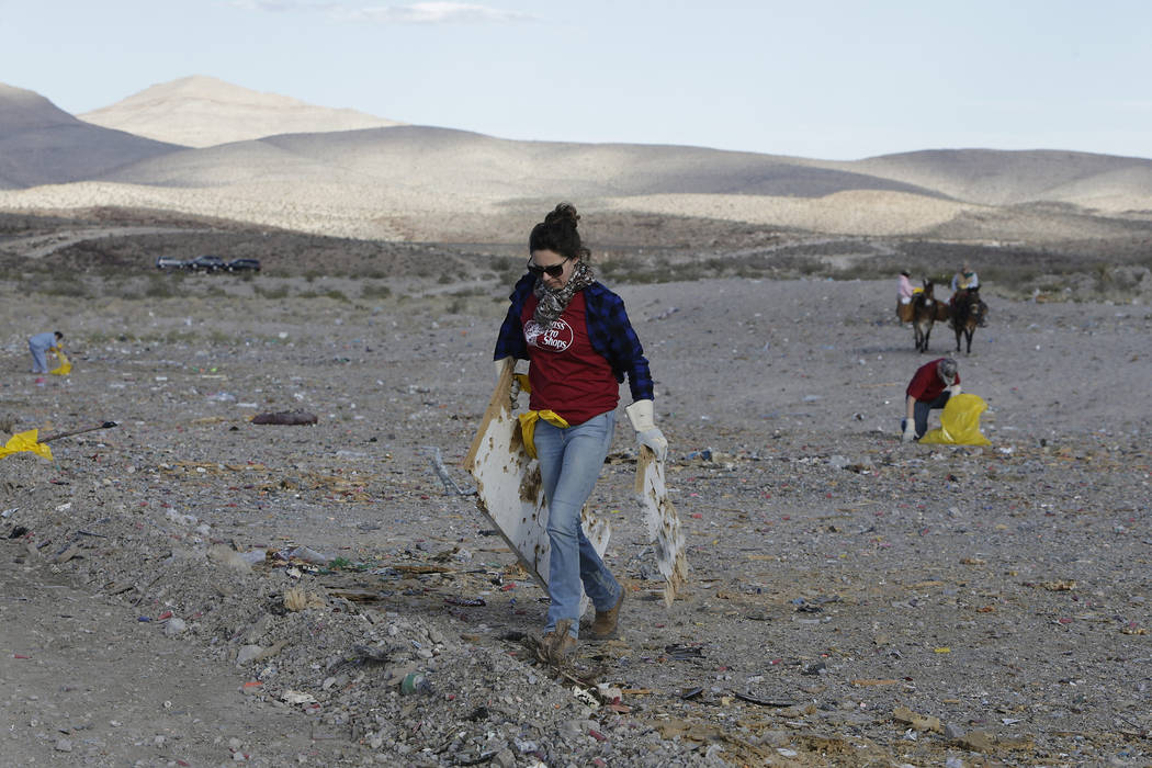 Volunteers collect debris during a volunteer cleanup hosted by the Bureau of Land Management at a popular target shooting area off South Las Vegas Boulevard, Saturday, Nov. 04, 2017.  (Photo by Ma ...