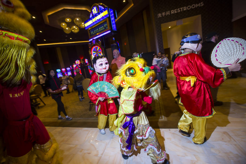 Members of the Lohan School of Shaolin entertain the crowd with a traditional lion and dragon dance during the 1-year anniversary of the Lucky Dragon in Las Vegas on Sunday, Dec. 3, 2017. Chase St ...