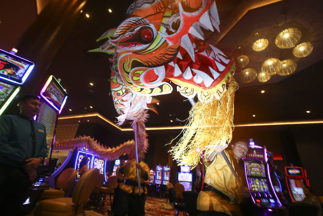 Oscar Cisneros, right, of the Lohan School of Shaolin entertains the crowd with a traditional lion and dragon dance during the 1-year anniversary of the Lucky Dragon in Las Vegas on Sunday, Dec. 3 ...