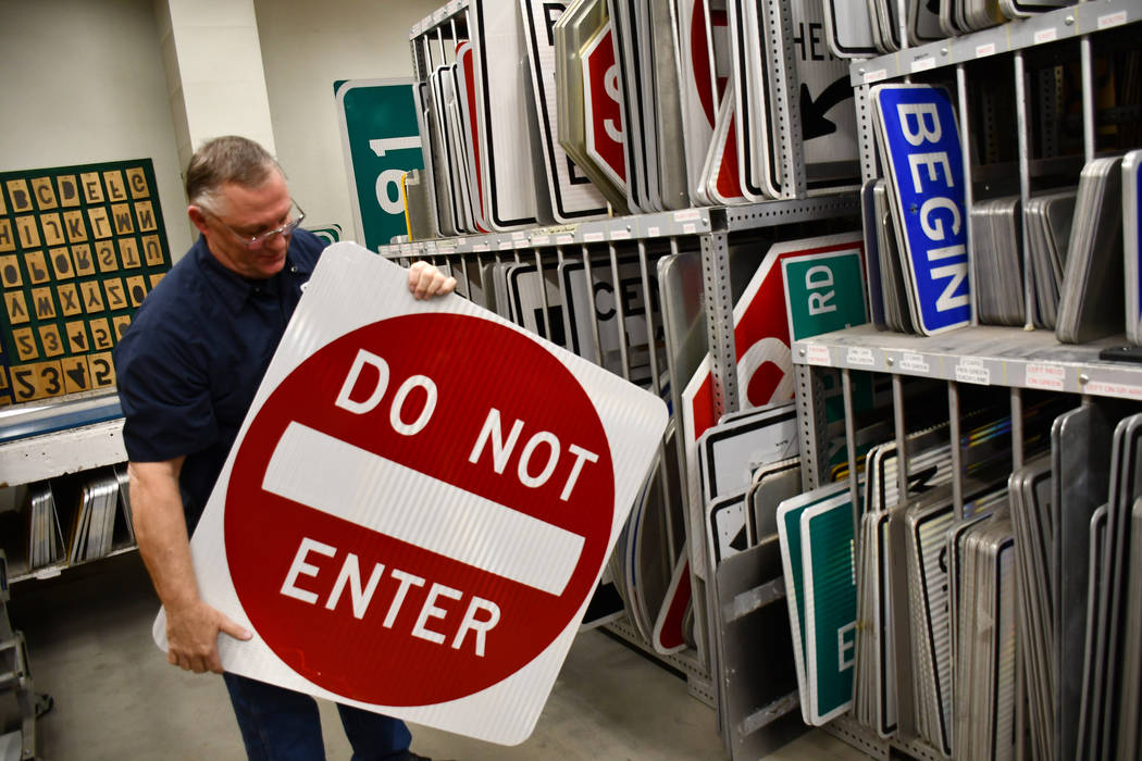 Keith Wroblewski, highway maintenance supervisor for the Nevada Department of Transportation District 1 demonstrates one of the freeway entrance signs at the NDOT's sign shop in Las Vegas. (Daria  ...