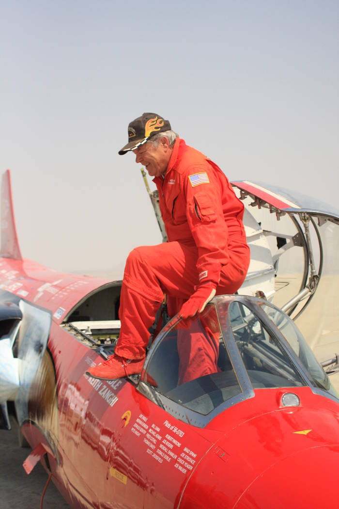 Ed Shadle climbs from the cockpit of the North American Eagle, a jet-powered car he hopes to drive next year to a new world land-speed record in Nevada. (North American Eagle)