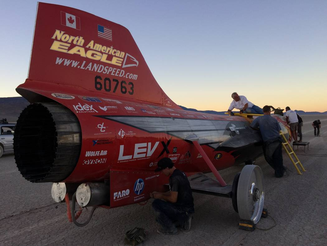 Team members work on the North American Eagle, a jet-powered car being prepped for a run at the world land-speed record next year in Nevada. (North American Eagle)