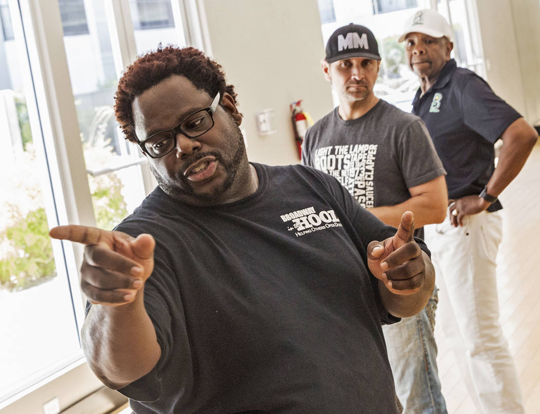 "Director Torrey Russell, left, works with performers Travis Cloer and Bubba Knight during rehearsal for Broadway in the Hood's show ""From Broadway With Love,"" on Tuesday, June 27, 2017, at Loft 5' ..."
