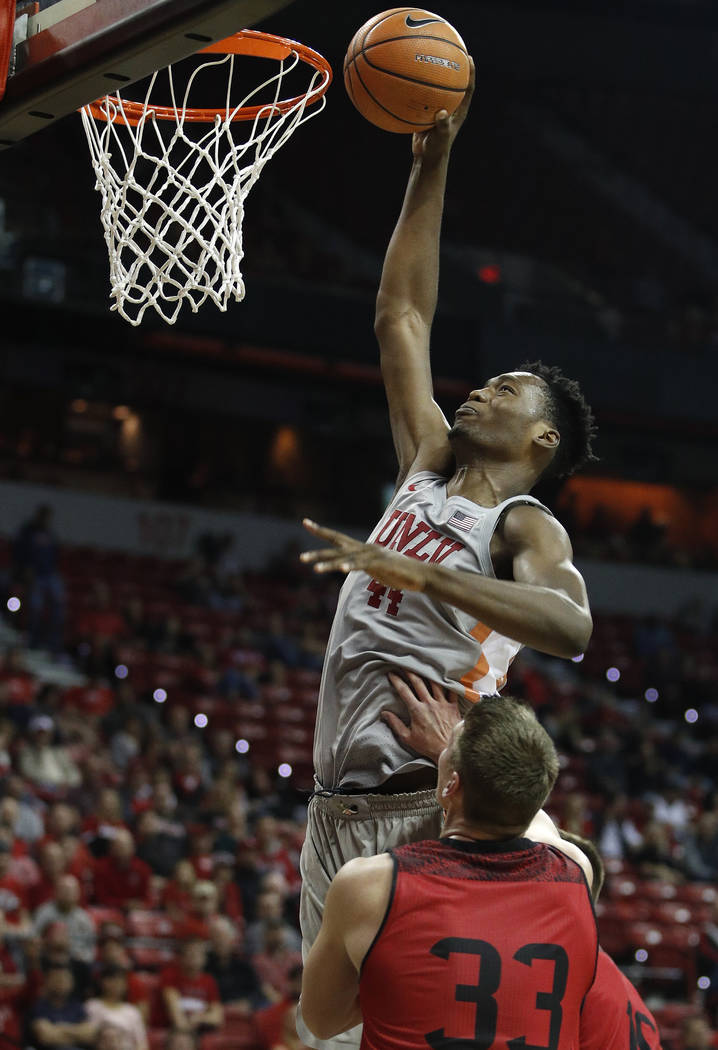 UNLV's Brandon McCoy dunks over Southern Utah's Matthew Johnson during the first half of an NCAA college basketball game Saturday, Nov. 25, 2017, in Las Vegas. (AP Photo/John Locher)