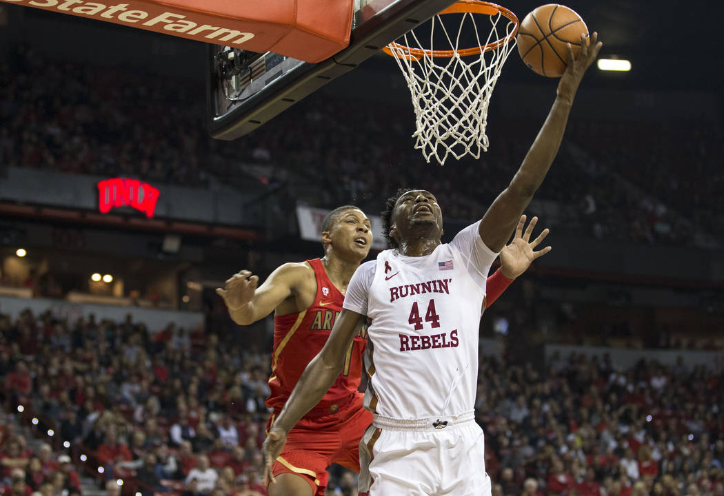 UNLV Rebels forward Brandon McCoy (44) goes for a reverse layup against Arizona Wildcats forward Ira Lee (11) during the first half of an NCAA college basketball game at Thomas & Mack Center i ...