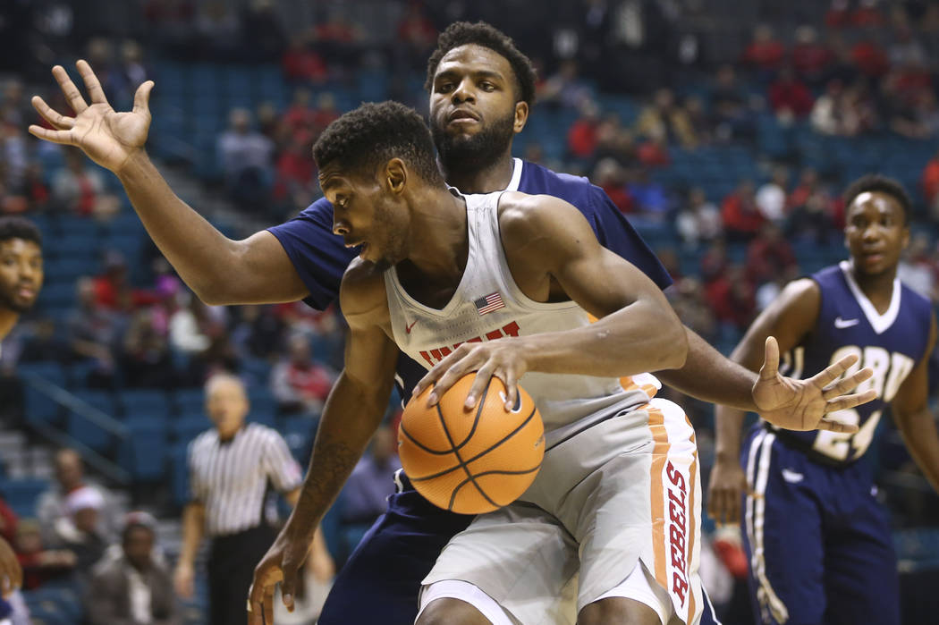 Oral Roberts' Chris Miller (52) defends UNLV's Shakur Juiston (10) during their basketball game at the MGM Grand Garden Arena in Las Vegas on Tuesday, Dec. 5, 2017. Chase Stevens Las Vegas Review- ...