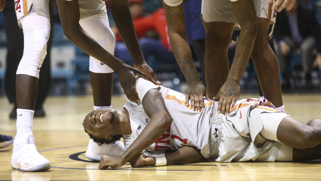 UNLV players check on Kris Clyburn (1) after a hard fall during their basketball game against Oral Roberts at the MGM Grand Garden Arena in Las Vegas on Tuesday, Dec. 5, 2017. UNLV won 92-66. Chas ...