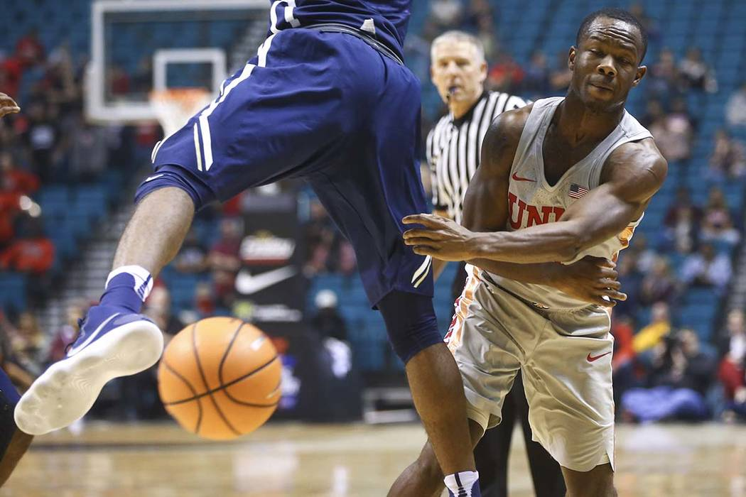 UNLV's Jordan Johnson (24) throws the ball past Oral Roberts' Emmanuel Nzekwesi (23) during their basketball game at the MGM Grand Garden Arena in Las Vegas on Tuesday, Dec. 5, 2017. Chase Stevens ...