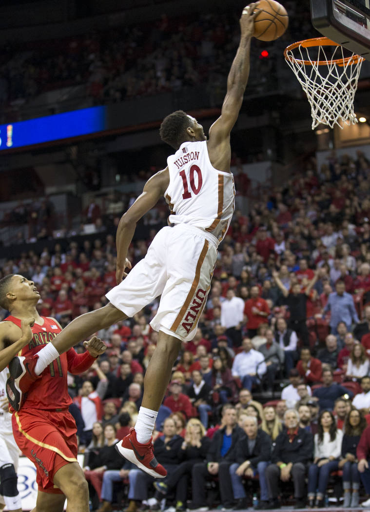 UNLV Rebels forward Shakur Juiston (10) dunks the ball against the Arizona Wildcats during the second half of an NCAA college basketball game at Thomas & Mack Center in Las Vegas on Saturday,  ...