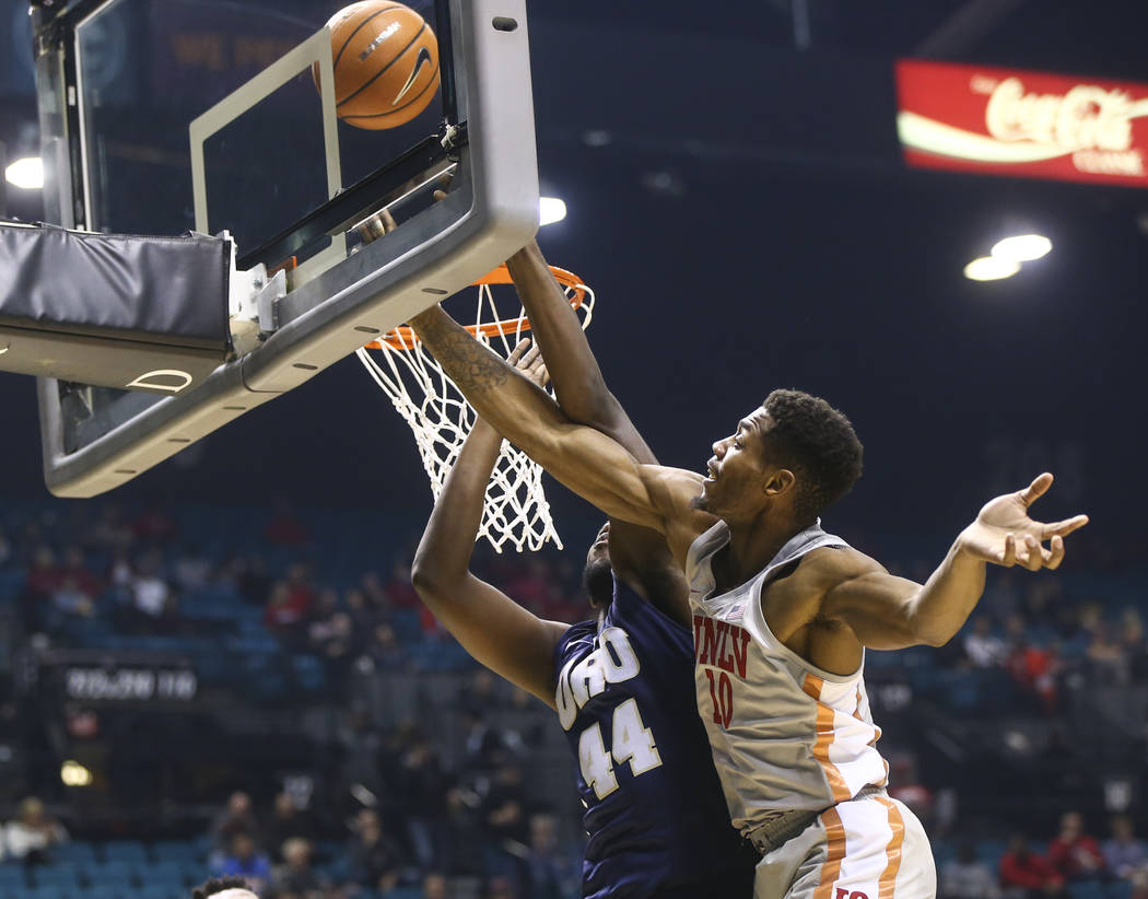 UNLV's Shakur Juiston (10) shoots over Oral Roberts' Albert Owens (44)during their basketball game at the MGM Grand Garden Arena in Las Vegas on Tuesday, Dec. 5, 2017. Chase Stevens Las Vegas Revi ...