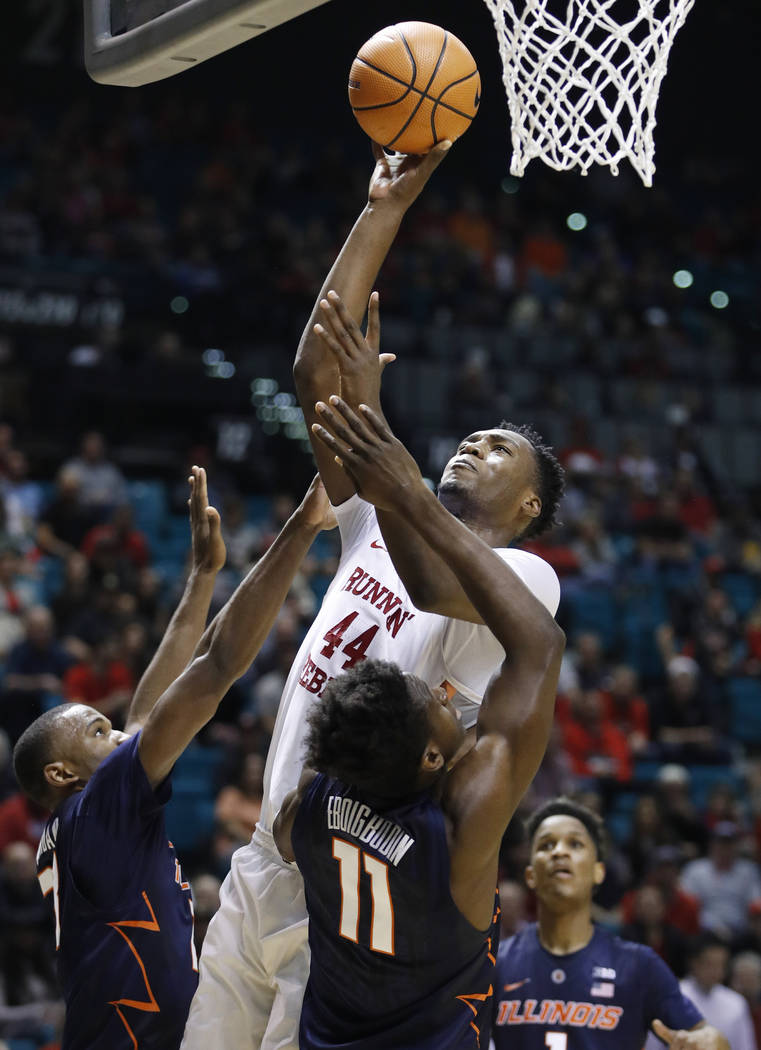 UNLV's Brandon McCoy shoots over Illinois' Aaron Jordan, left, and Greg Eboigbodin during the first half of an NCAA college basketball game Saturday, Dec. 9, 2017, in Las Vegas. (AP Photo/John Locher)