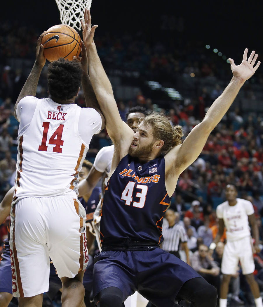 Illinois' Michael Finke, right, fouls UNLV's Tervell Beck during the first half of an NCAA college basketball game Saturday, Dec. 9, 2017, in Las Vegas. (AP Photo/John Locher)