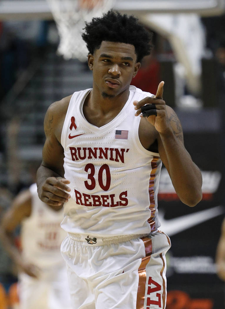 UNLV's Jovan Mooring reacts after scoring against Illinois during the second half of an NCAA college basketball game Saturday, Dec. 9, 2017, in Las Vegas. (AP Photo/John Locher)