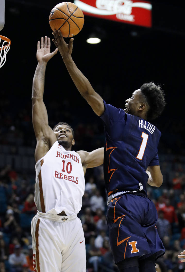 Illinois' Trent Frazier shoots over UNLV's Jovan Mooring during the second half of an NCAA college basketball game Saturday, Dec. 9, 2017, in Las Vegas. (AP Photo/John Locher)